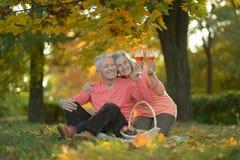 Happy mature couple having picnic Stock Photo