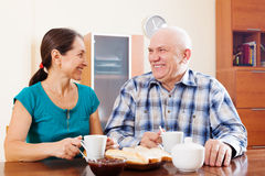 Happy mature couple having tea Royalty Free Stock Photo