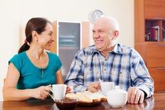 Happy mature couple having tea Royalty Free Stock Photo