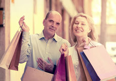 Happy mature couple holding bags after shopping Royalty Free Stock Image