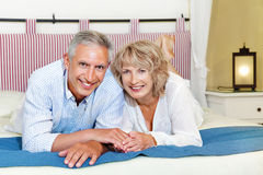 Happy mature couple at home Royalty Free Stock Photos