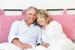 Happy mature couple at home royalty free stock photography