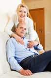 Happy mature couple in home interior Stock Photography