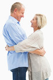 Happy mature couple hugging and smiling Stock Image