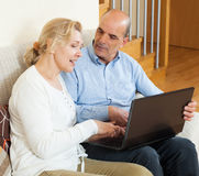 Happy mature couple  with laptop Stock Photos