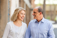 Happy mature couple looking at each other on a date Stock Photography