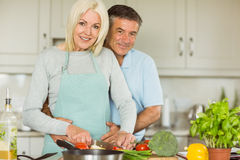 Happy mature couple making dinner together Stock Photo
