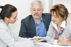 Happy mature Couple in Meeting With Advisor Stock Photography
