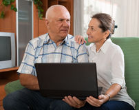 Happy mature couple  with noteboo Royalty Free Stock Photo