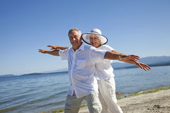 Happy Mature Couple on Ocean Beach Royalty Free Stock Images