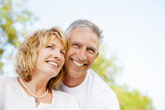 Happy mature couple outdoors. Bright lifestyle portrait of a happy mature couple outdoors Stock Photo