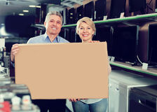 Happy mature couple purchased and packed goods Royalty Free Stock Images