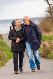 Happy mature couple relaxing baltic sea dunes Royalty Free Stock Photos