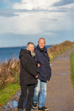 Happy mature couple relaxing baltic sea dunes Stock Image