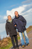 Happy mature couple relaxing baltic sea dunes Royalty Free Stock Photo