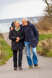 Happy mature couple relaxing baltic sea dunes. In autumn Royalty Free Stock Photo