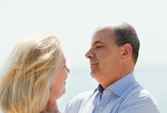 Happy mature couple  with sea beach in background Stock Photography