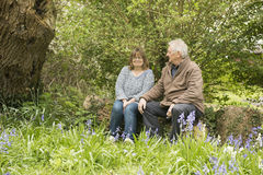 Happy mature couple sitting outdoors Royalty Free Stock Photo