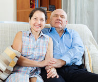Happy mature couple sitting   together in home Stock Photo