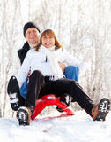Happy mature couple sledding royalty free stock photography