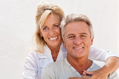Happy mature couple. Smiling and embracing royalty free stock photography