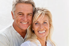 Happy mature couple. Smiling and embracing stock photography
