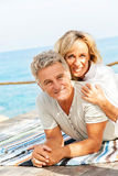 Happy mature couple. Smiling and embracing outdoors stock photo