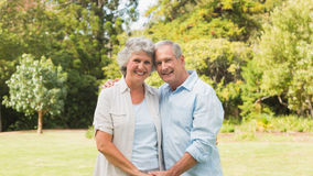 Happy mature couple smiling and looking at camera Stock Images
