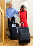Happy mature couple with suitcases looking in mirror Stock Image