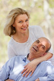 Happy mature couple at summer park Royalty Free Stock Photography