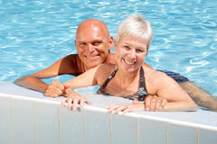 Happy mature couple in the swimming pool Royalty Free Stock Photography