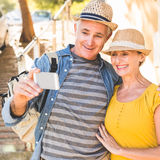 Happy mature couple taking a selfie together in the city Royalty Free Stock Photography