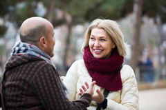 Happy mature couple talking outdoors Stock Photo