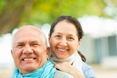 Happy mature couple together in autumn park Royalty Free Stock Images