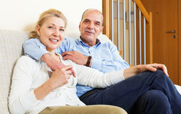 Happy mature couple together in home interior Royalty Free Stock Images