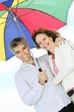 Happy mature couple with umbrella stock image