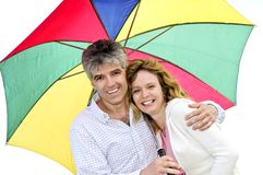 Happy mature couple with umbrella Royalty Free Stock Photography
