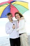 Happy mature couple with umbrella Stock Photo
