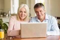 Happy mature couple using laptop Royalty Free Stock Photo