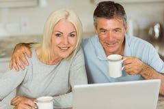Happy mature couple using laptop Royalty Free Stock Photos