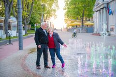 Happy mature couple  vacations in a city