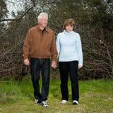 Happy mature couple walking outdoors stock photos