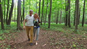 Happy mature couple walking on trail stock footage
