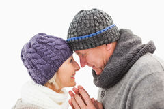 Happy mature couple in winter clothes embracing Royalty Free Stock Photo