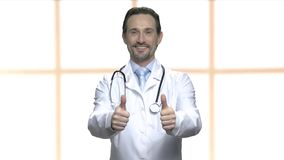 Happy mature doctor showing two thumbs up. stock footage