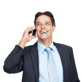 Happy mature executive on cellphone Royalty Free Stock Photo
