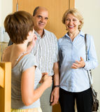 Happy mature family couple visiting adult daughter Royalty Free Stock Photography