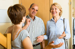 Happy mature family couple visiting daughter Royalty Free Stock Photo
