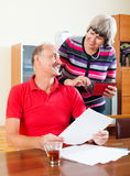Happy mature family with financial documents royalty free stock photography