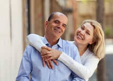 Happy mature family hugging together at walking Royalty Free Stock Photography